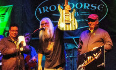 AA Bottom Presents Signed guitar to Iron Horse Pub